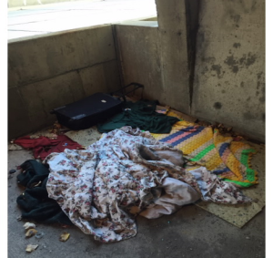 A homeless encampment is located behind a concrete wall on the trail. Photograph by Beth Turnbull.