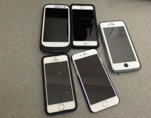 Five different mobile phones. Photo by Alicia Green