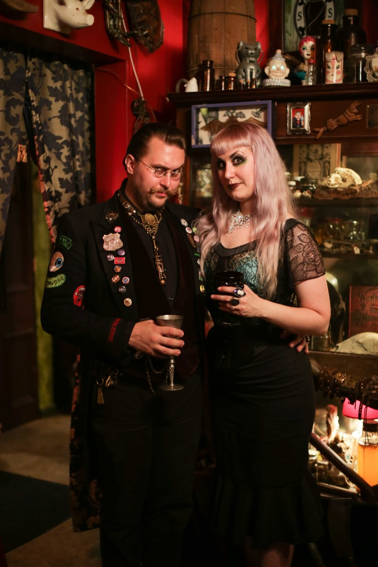 Mr Arm and Velda Von Minx stand in their parlor, surrounded by their collection of oddities. Photo by Hannah Harley